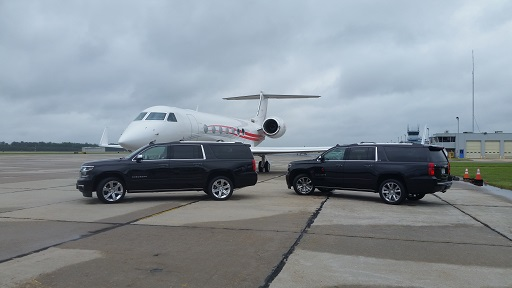2017 Chevrolet Suburban Premier, 2016 Chevrolet Suburban LTZ and private jet at Atlantic Aviation at Newport News airport